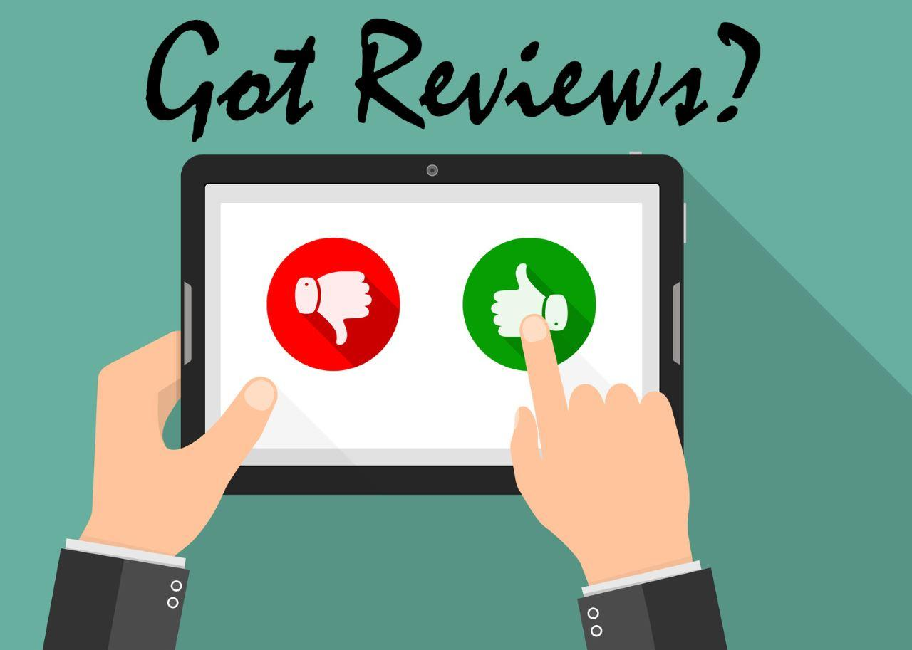 "hands on a tablet choosing between thumbs up or thumbs down.  Caption says ""Got Reviews"""